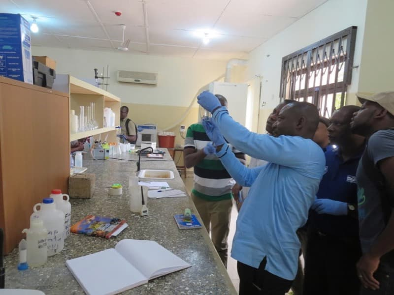 Photo fo WASH students in lab