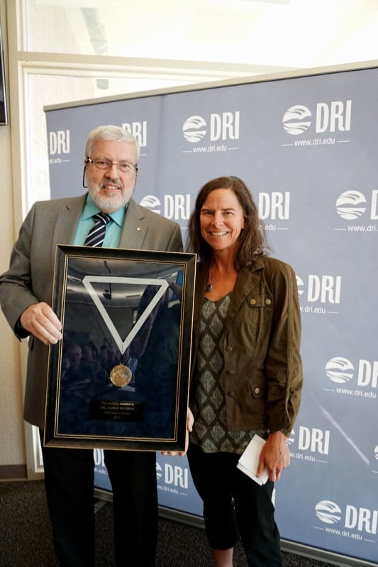 Executive Director of Atmospheric Sciences Marc Pitchford presents the 2019 DRI Science Medal to Dr. Alison Murray.