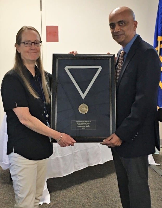 Dr. Kumud Acharya, DRI President, presents the 2019 Outstanding Contributions Medal to Jenny Chapman.
