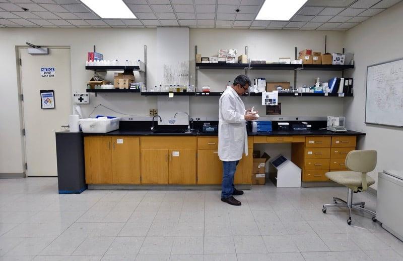 Erick Bandala, Ph.D. at work in DRI's Environmental Engineering Lab. Credit: Dave Becker, Nevada Momentum.