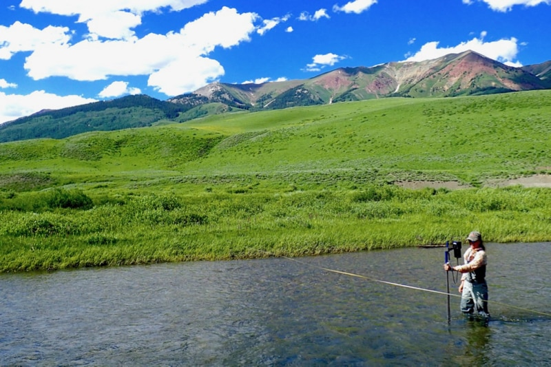 DRI scientist Rosemary Carroll stands in the East River measuring stream discharge in Colorado.