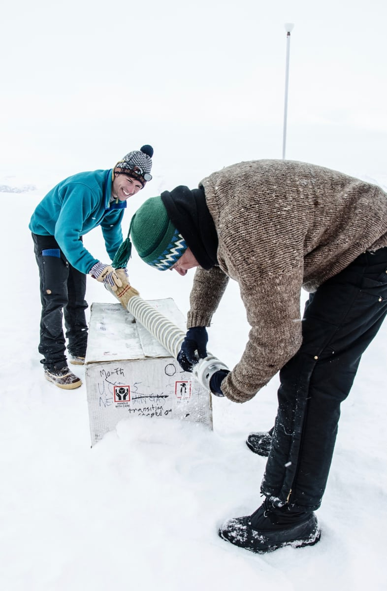 University of Arizona postdoctoral research associate Matthew Osman and U.S. Ice Drilling Program specialist Mike Waszkiewicz move an ice core barrel into place in West Greenland, as part of their work to study ice caps' response to climate change.