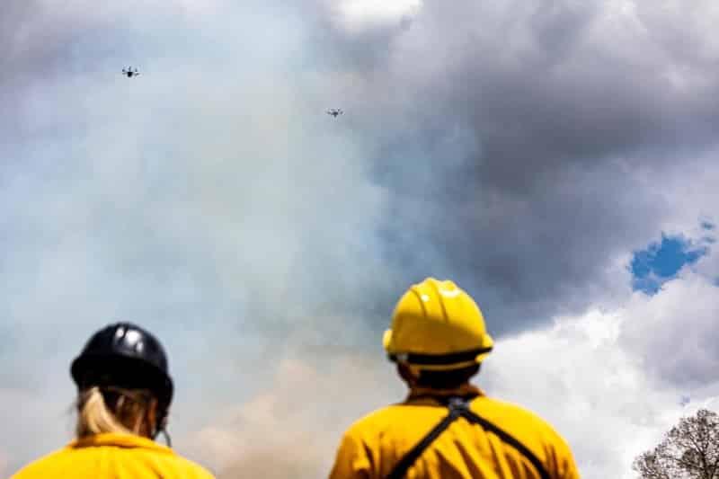 drone pilots looking through smoke