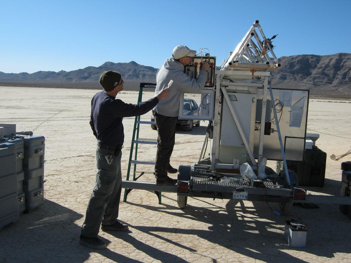 Scientists inspect dust measurement device
