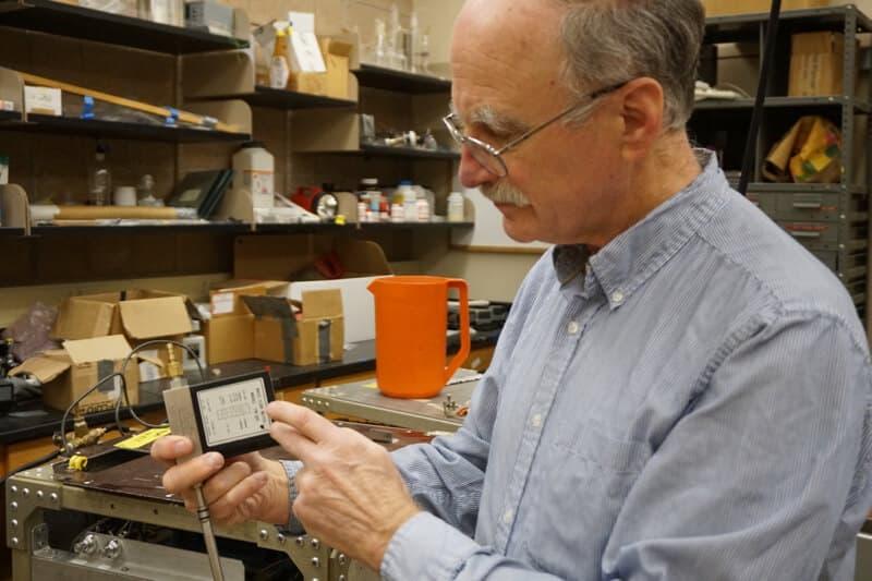 Jim Hudson examines an instrument screen inside of the Aerosol Physics Laboratory at DRI.