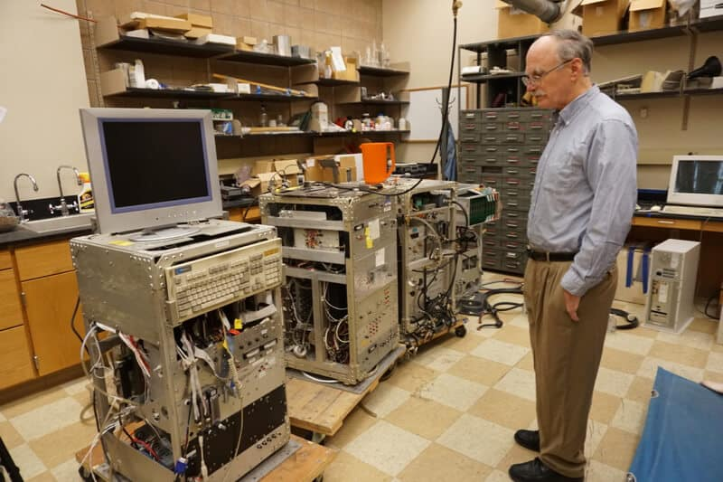 Jim Hudson stands near a CCN Spectrometer, an instrument designed by Jim and other DRI team members to measure cloud condensation nuclei from an aircraft.