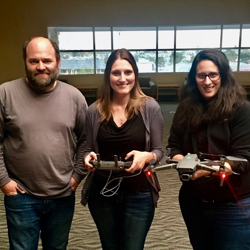 Researchers holding drones.