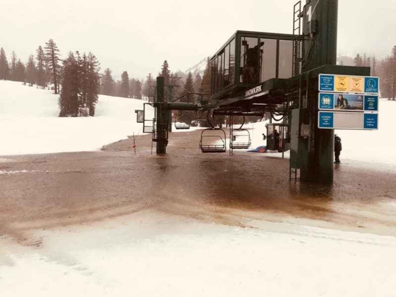 A ski lift at Kirkwood ski resort during a warm storm